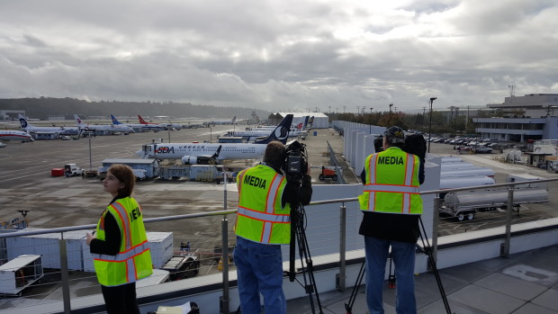 Television crews film during the grand opening of Boeing's new delivery center in Seattle. (GeekWire Photo, Jacob Demmitt)