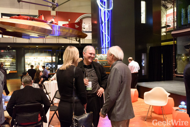 Tom Alberg chats with guests at the 20th anniversary party