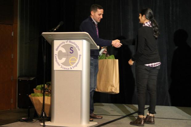 Rajalakshmi Nandakumar accepts the runner-up award for her sleep apnea technology. Photo via UW/Kristin Osborne.