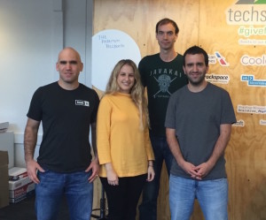Ehud Halberstam (far left) and Amit Halberstam (far right) with some of their Brand.ai team.