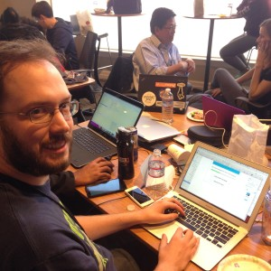 Calvin Freitas, a senior front-end engineer at Amazon, works on Ceaseless, at the second-annual Code for the Kingdom Seattle (Will Mari / Geekwire).
