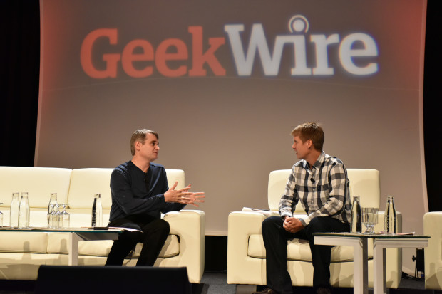 Greg Gottesman speak with John Cook at the GeekWire Summit on Thursday.