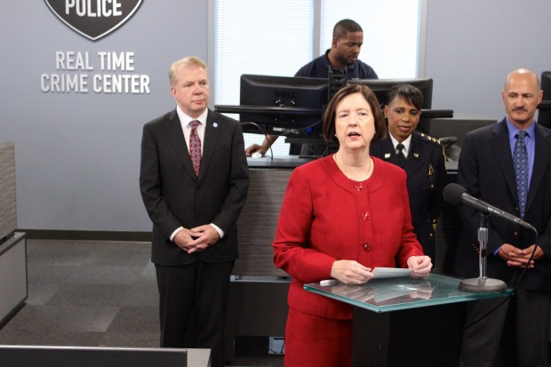 Seattle Police Chief Kathleen O'Toole speaks on Wednesday at the new SPD Real Time Crime Center. Seattle Mayor Ed Murray stands in the back.