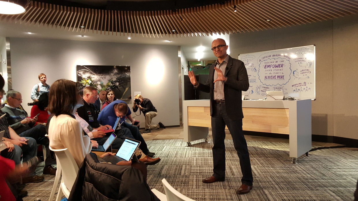 Microsoft CEO Satya Nadella speaks to a group of teachers at the company's Redmond, Wash. headquarters. (GeekWire Photo, Jacob Demmitt)