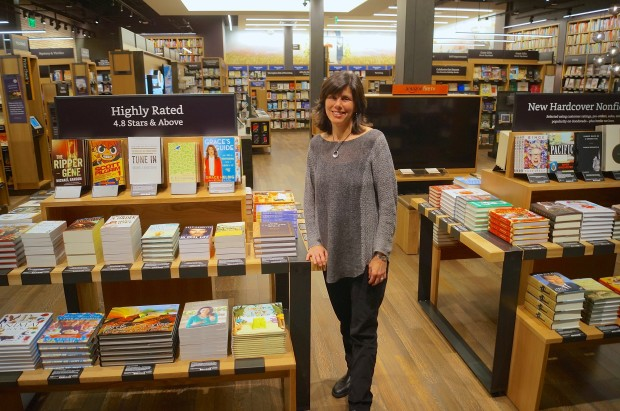 Amazon Books VP Jennifer Cast stands inside Amazon's first physical retail location in Seattle.