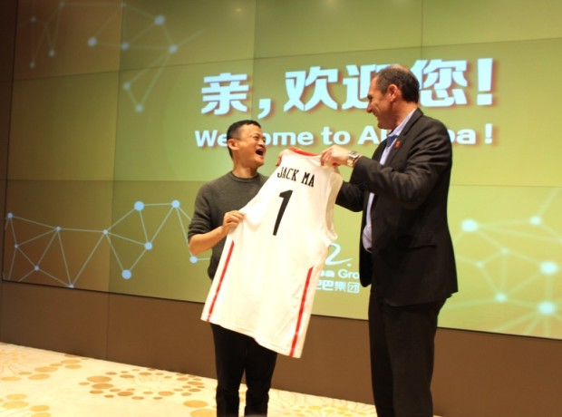 Pac-12 Commissioner Larry Scott presents Alibaba founder Jack Ma with his own basketball jersey.