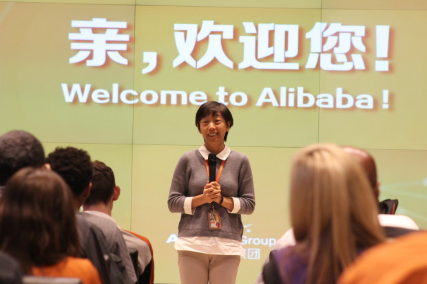 Alibaba co-founder Jane Jiang speaks at the company headquarters on Tuesday to a group of University of Washington and University of Texas basketball players.