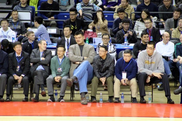 f9306341f Pac-12 Commissioner Larry Scott (second from left) sits next to Alibaba  Vice Chairman Joe Tsai (third from left) and Chinese basketball legend Yao  Ming.