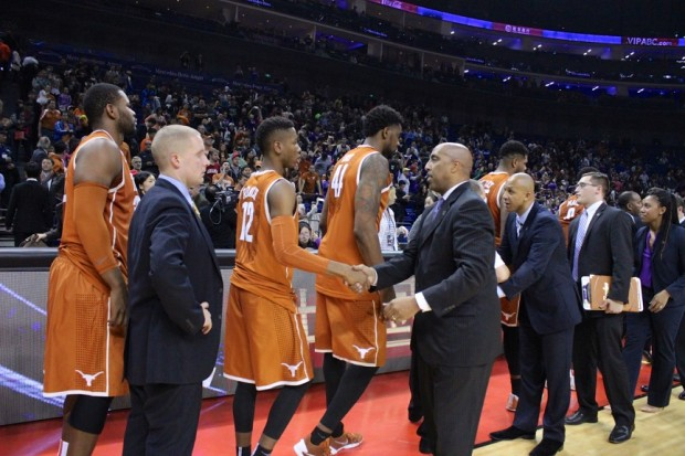 Players and coaches from the UW and Texas shake hands after the UW's 77-71 win.