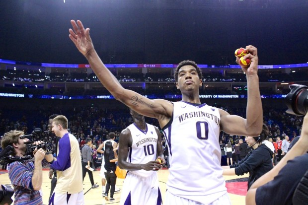 UW freshman guard Marquese Chriss throws autographed basketballs into the crowd after his team's 77-71 win over Texas.