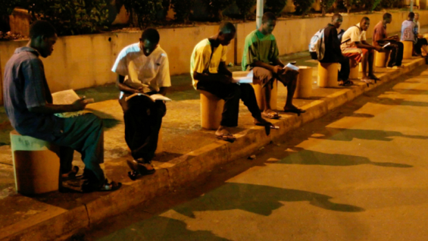 "Photo via Gates Notes/ ""Students in Conakry, Guinea. They're studying under street lamps, because they don't have reliable lights at home,"" Gates writes."