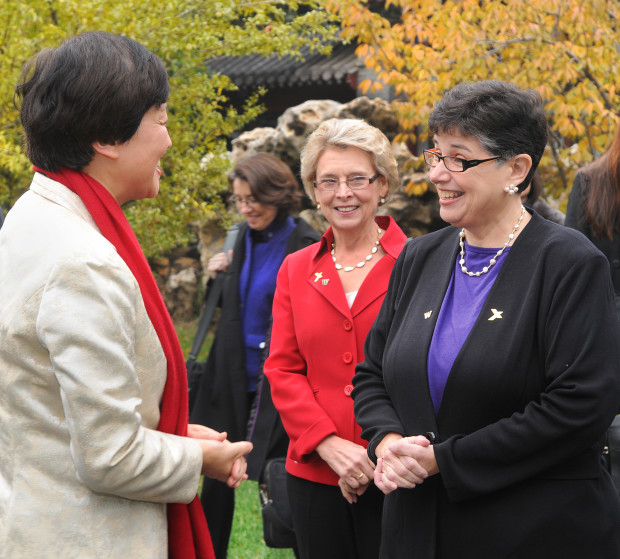 Tsinghua University Chairperson Chen Xu greets University of Washington President Ana Mari Cauce at the historic Gong Zi Ting on Tsinghua's campus in Beijing. (Dan Schlatter/University of Washington)