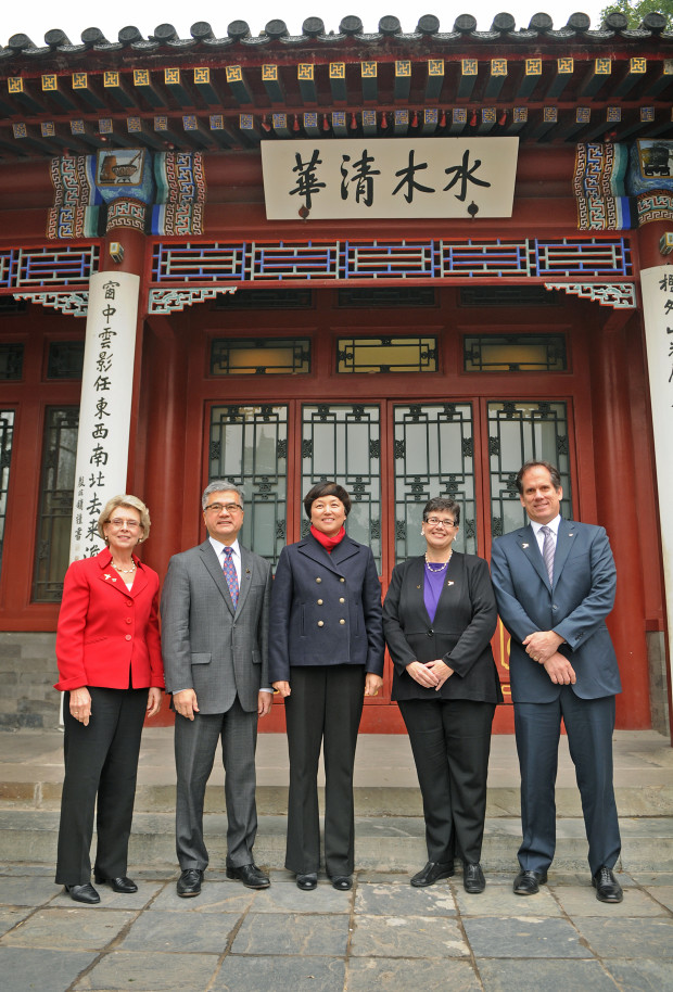 From left: Former Washington Governor Chris Gregoire, former U.S. Ambassador Gary Locke, Tsinghua University Chairperson Chen Xu, University of Washington President Ana Mari Cauce, and Microsoft Corporate Vice President Rich Sauer at the historic Gong Zi Ting on the campus of Tsinghua University in Beijing. (Dan Schlatter/University of Washington)