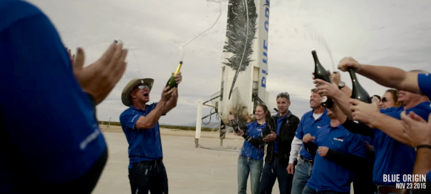 Jeff Bezos celebrates the vertical takeoff and landing of Blue Origin's New Shepard rocket