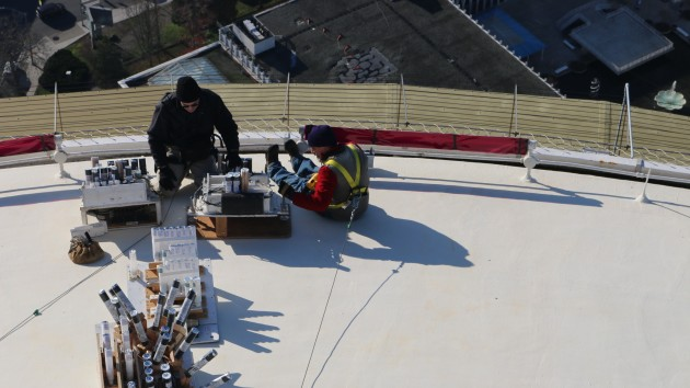 Workers prepare the 2016 show at the top of the Space Needle this week. (Photo: Alyssa Rasmus, Pink Camera Media.)
