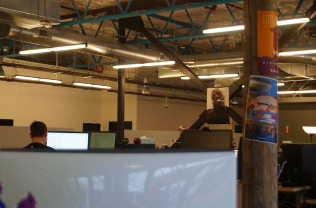 Photo via GeekWire/Molly Brown/KEXP's new open office plan complete with Notorious B.I.G. poster
