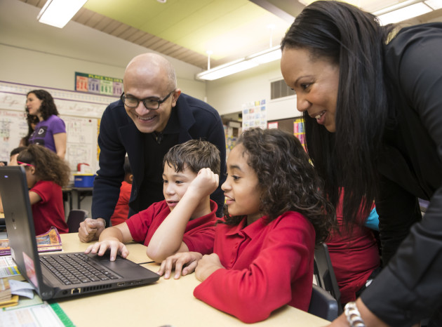 Microsoft CEO Satya Nadella, left, and Principal Anitra Pinchback-Jones, right, observe as Rainier View Elementary School students take part in the Hour of Code on Monday Dec. 7, 2015 in Seattle. Hour of Code introduces to programming and computer science throughout the world. (Stephen Brashear/AP Images for Microsoft)
