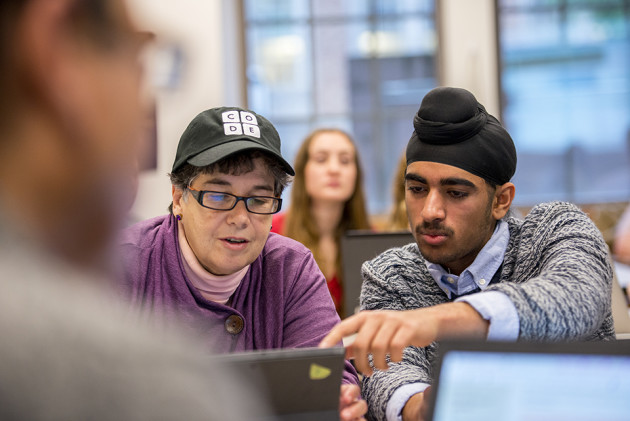 University of Washington President Ana Mari Cauce and student Sukhdeep Singh participate in the Hour of Code. Photo via Dennis Wise/University of Washington.