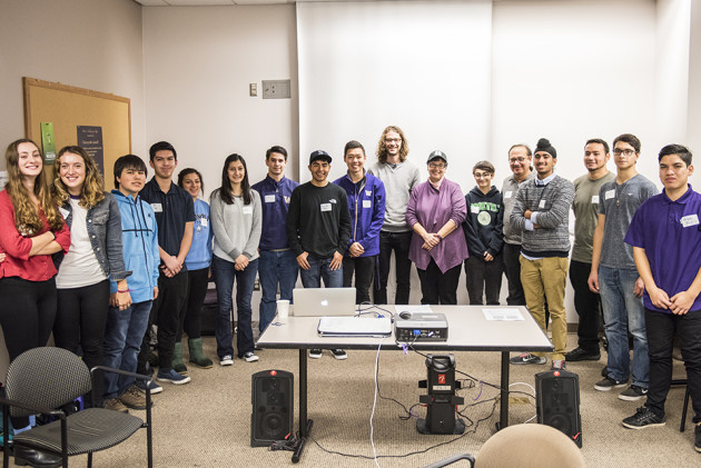 UW President Ana Mari Cauce poses with her fellow programmers at the conclusion of their Hour of Code. Photo via Dennis Wise/University of Washington.