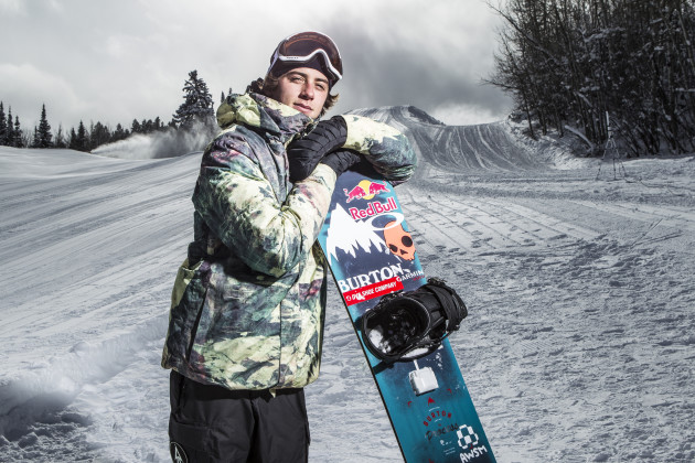 Snowboarder and X Games competitor Mark McMorris with his snowboard that has Intel's motion-tracking device attached. Photo via Intel/ESPN.