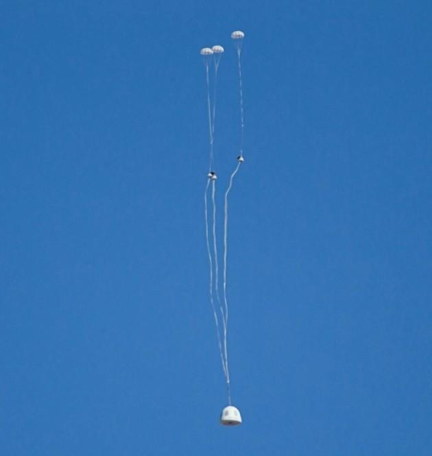 Blue Origin capsule with parachutes