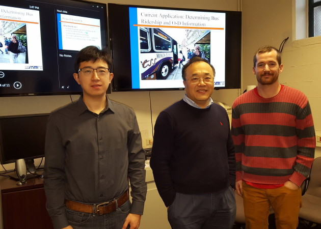 Zhibin Li, Kris Henrickson and Yinhai Wang from the University of Washington's Department of Civil and Environmental Engineering are developing a way to use the Wi-Fi and Bluetooth signals from bus passengers in order to better understand bus use. Photo: Lisa Stiffler.