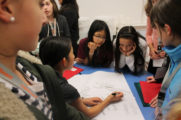 Participants of Startup Weekend Girls play an icebreaker game to get them thinking about what makes a good startup on Jan. 22, 2016 in Lake Washington Girls Middle School in Seattle.
