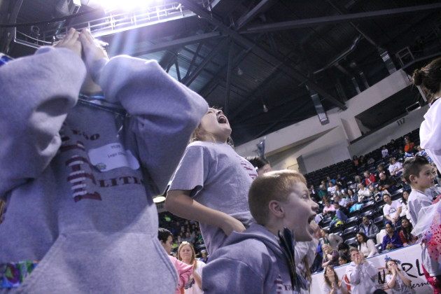 Students from the Lego Elites, a robotics team from Naches Trail Elementary, cheer for their team members during a match on Saturday.