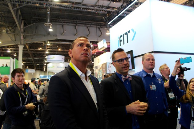 Alex Rodriguez checks out the Fitbit booth at CES