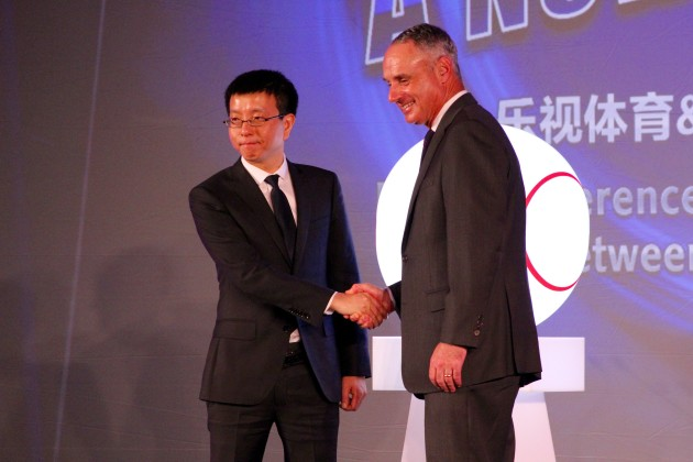Le Sports CEO Lei Zhenjian and MLB Commissioner Rob Manfred shake hands at CES in Las Vegas last month. (GeekWire photo)