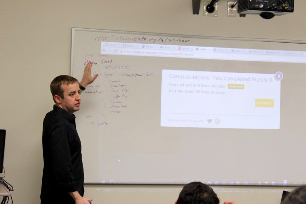 Microsoft engineering manager Rick Duncan helps team the SUA students about coding.