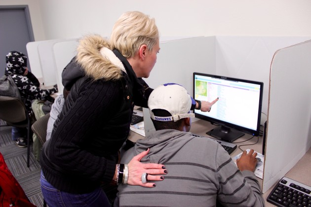 Code Fellows Seattle Campus Director Brandy Rhodes helps a student learn how to code.