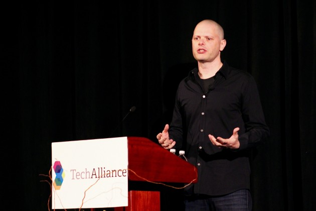 VREAL CEO Todd Hooper speaks at a Tech Alliance event in Seattle on Thursday.