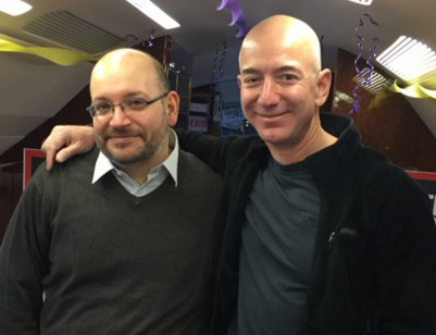 Jeff Bezos escorting Washington Post reporter Jason Rezaian home after improsnment in Iran. (Washington Post via Twitter).