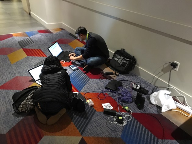 Attendees at CES compete to find power outlets.