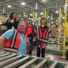 Make-A-Wish recipient Evan tours Amazon Fulfillment Center. Photo via Amazon.