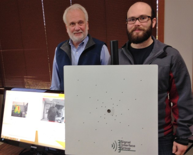 Signal Interface Group's Neil Fenichel and his son, Abraham Fenichel, show off their acoustic imaging array. (GeekWire photo by Alan Boyle)