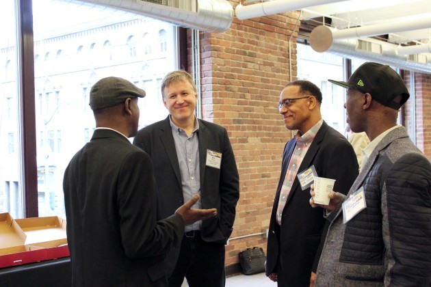 Councilmember Mike O'Brien chats with Eastside for Hire Manager Abdul Yusuf (left) and Flat Rate for Hire Vehicle Association leader Henry Yates (second from right) at an event last month in Seattle.