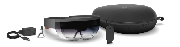 The development kit includes the HoloLens headset, a clicker, extra nosepiece, charger and carrying case. Image via Microsoft.