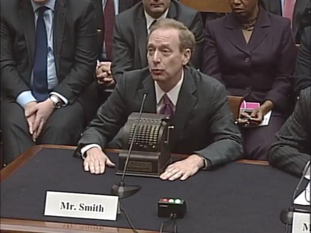 Smith and his adding machine. Image via livestream of the testimony