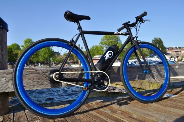 Propella's emphasis on design shines through. The e-bike comes with red, blue, white, or black wheels.