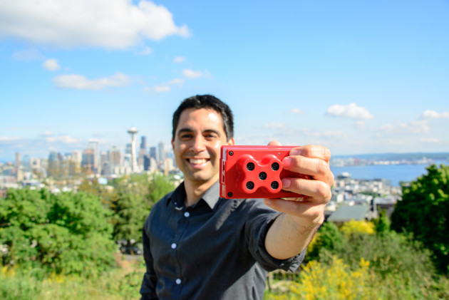 Micasense CEO Gabriel Torres with the company's new device. Photo via Micasense.