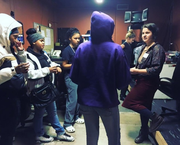 Reel Grrls program manager Stephany Koch Hazelrigg, far right, working with students. Photo: Reel Grrls.