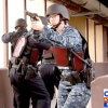 Security personnel at a naval air station wear StressVests during training.