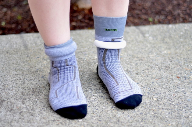 A pair of sensor-endowed socks are at the center of Sensoria's wearable system. You fold the socks over a cuff-like anklet to keep them from flying off during your run.