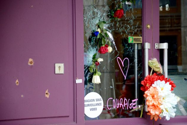 Bullet holes were filled with flowers at one of the restaurants involved in the November 13 terrorist attacks in Paris. (Credit: Greg Sandoval)