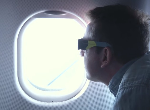 A passenger aboard a Lufthansa flight watches a solar eclipse out the window in March 2015. Passengers on an Alaska Airlines flight will have a similar opportunity on Tuesday. (Credit: Lufthansa via YouTube)
