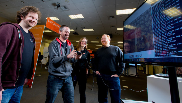 David Bignell, Tim Hutton, Katja Hofmann and Matthew Johnson are part of the Minecraft artificial intelligence project. (Photo by Scott Eklund/Red Box Pictures, for Microsoft)