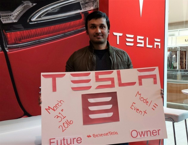 Sid Bharadwaj, the first buyer in line at Tesla Motors' Bellevue Square store, has his selfie taken after putting down a $1,000 deposit for a Model 3 electric car. (Credit: Sid Bharadwaj / Tesla Motors)