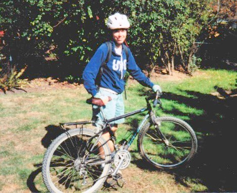 Gail Murphy with her mountain bike and wearing a University of British Columbia sweatshirt that foreshadows her career path. Photo from the mid-1990s.